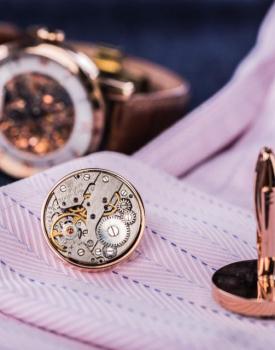 Aproču pogas ar pulksteņa mehānismu rozā zelta krāsā