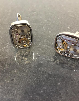 Cufflinks are silver-colored