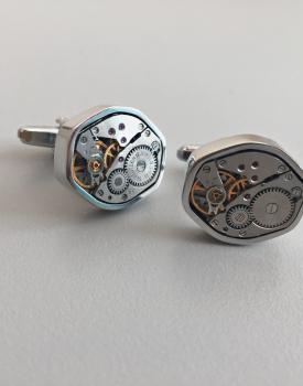 Aproču pogas ar pulksteņa mehānismu - kantainas